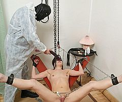 Bizarre pussy pain and bondage of clamped and hotwaxed brunette slavegirl Lola from The Pain Files