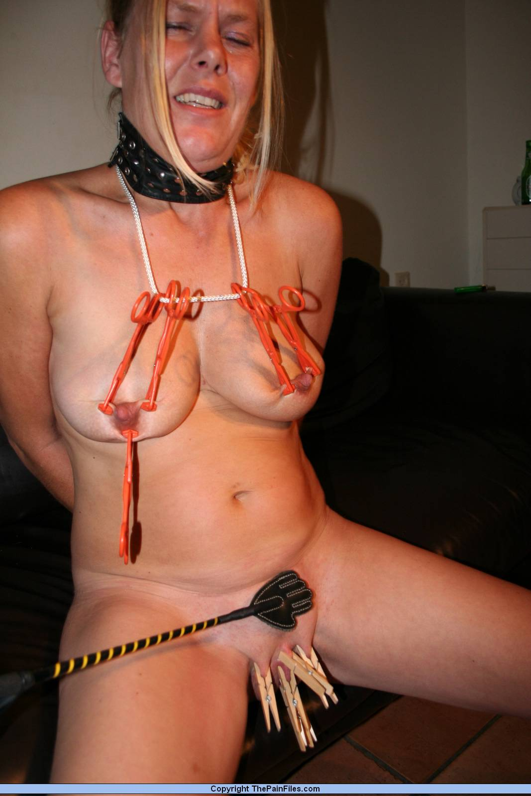 image Girl tortured with clothespins and whipped