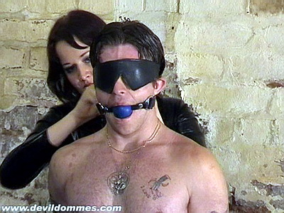 Femdom ballgagging and tit tormenting her bound male slave in the dungeon from Devil Dommes