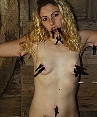 Amateur Kats harsh bdsm and clamped agony tied up in a wooden shed from The Pain Files