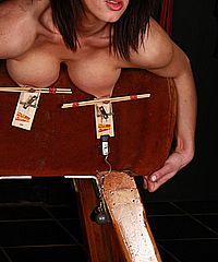 Mousetrap nipple torture and carpet beater spanking of busty uk amateur slavegirl Daniella in humiliating punishments on the gymnastics bench from The Pain Files