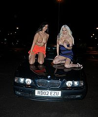 Busty flashers Gemma Maddock and Dolly Delight in UK. Two babes big tits flashing and teasing UK pornstars stripping in the streets of Bristol with blonde babe Dolly Delight and dark Gemma Maddock for pure exhibitionist pleasure from UK Flashers