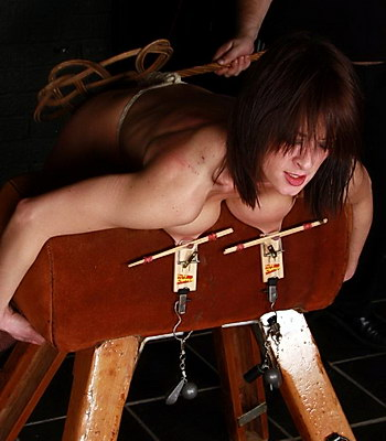 Brutal bdsm and carpet beating of mousetrap nipple tormented and spanked busty slavegirl Danii in the dungeon from The Pain Files