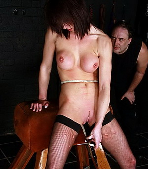 Dungeon domination and whipping of busty Daniela in pain and strange insertions at the punishment bench from The Pain Files