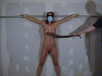 Bondage slavegirl Daniellas painful big breast whipping in the dungeon from The Pain Files