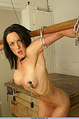 Busty brunette bdsm slave in extreme tit torments in the dungeon of pain from The Pain Files