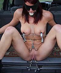 Busty slave girl Daniis outdoor bdsm and public punishment in disgraceful tit torture from The Pain Files