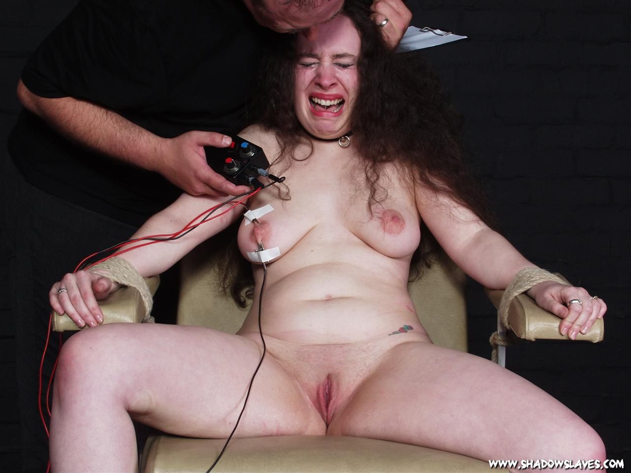 image Extreme electro bdsm and wooden device bondage of slave elis