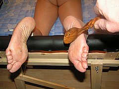 Lesbian mistress in extreme bastinado and foot spanking of her bound slavegirl from The Pain Files