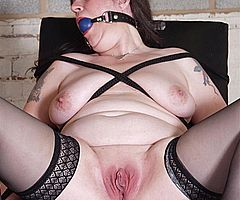ballgagged mature slave pussy clamped and hotwax tormented inside her open vagina from Shadow Slaves