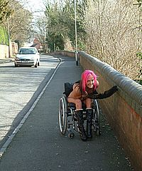 Disabled public nudity and pussy flashing by redhead Uk babe Leah Caprice showing tits and genitals to passing traffic from her wheelchair from UK Flashers