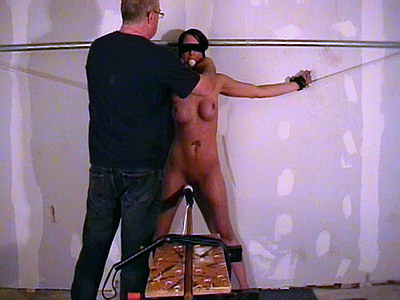 Depraved blindfolded bondage and breast whipping for ballgagged Daniella on the fucking machine from The Pain Files