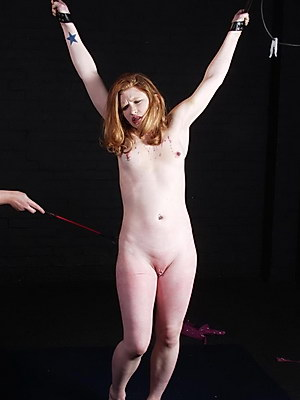 Lesbian bdsm of Madison Young in hardcore whipping from Shadow Slaves