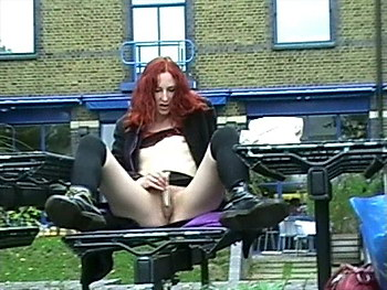 Amateur redhead Monicas public masturbation and couragious flashing of her pussy outside a cafe and in a public park from UK Flashers