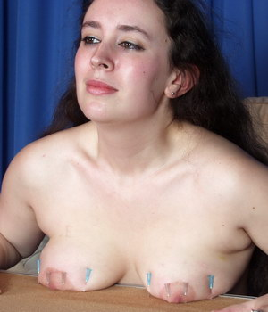 Tits Nailed To Table