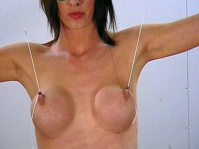 Extreme bdsm nipple torments of Daniellas big tits in the dungeon from The Pain Files