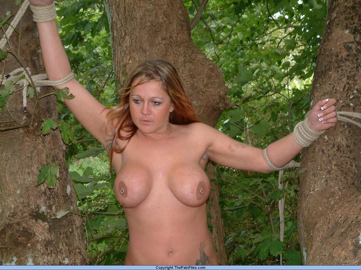 slave girl tied outdoors