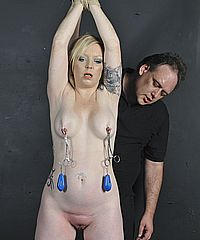 Painsluts erotic torture and nipple clamped torments of blonde slavegirl Angel in screaming agony and hardcore bdsm from The Pain Files