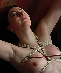 Pandora Blakes lesbian spanking and tied up caning of her tits by mistress Nimue from Nimues World