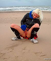 Public pissing on the beach and flashing by blonde English amateur Chaos taking liberties and flashing her pussy by the sea from UK Flashers