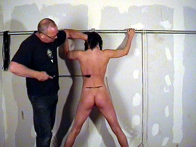 Spanking and bound whipping of pussy tormented busty bdsm slavegirl Daniella from The Pain Files
