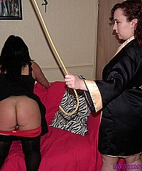 Room mate spanking and caning of bbw amateur Andrea by her strict lesbian spanker Nimue from Nimues World
