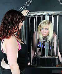 Satines lesbian teen bondage and lezdom domination of blonde fetish slave Satine Spark in caged restraints and tit torture by mistress Nimue from The Pain Files