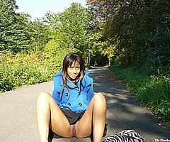 Ebony teen babe Candy masturbating and pussy flashing in public outdoors with hairy chicka from UK Flashers