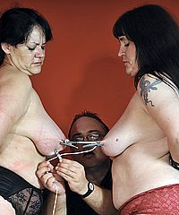 Two mature amateur slaves whipped and tit tortured to tears with painsluts Andrea and Jay in cruel bdsm. The two experienced english slave girls are whipped on their tits, clamped and punished from Shadow Slaves