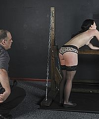 Teen slavegirl Kamis wooden horse bondage and whipped English amateur painsluts in harsh suction cupped nipple torture from Shadow Slaves