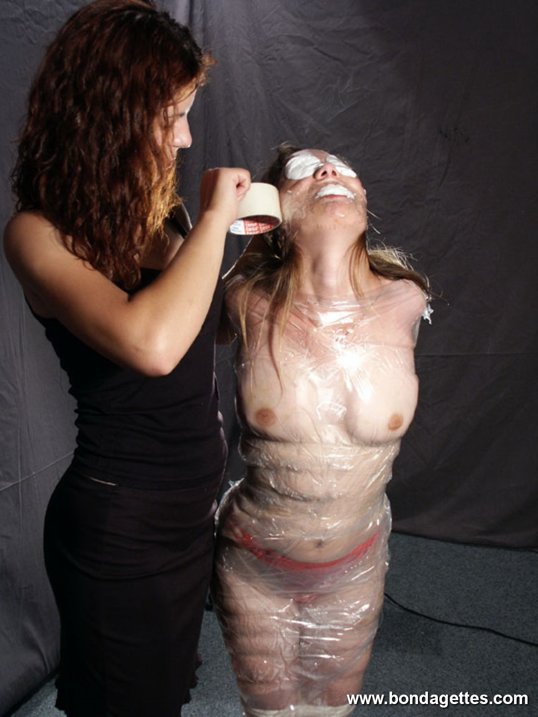 Amateur slave louise plastic wrapped bondage and candlewax punishment 2