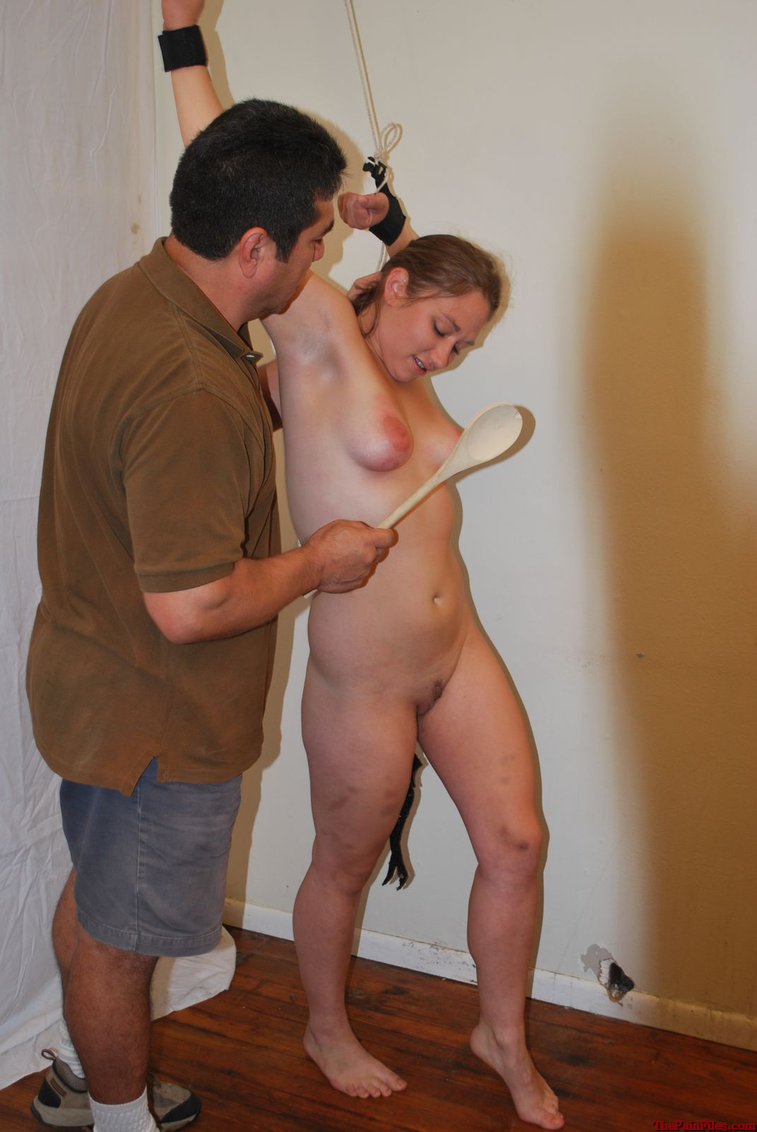 Forced stripped naked woman punish