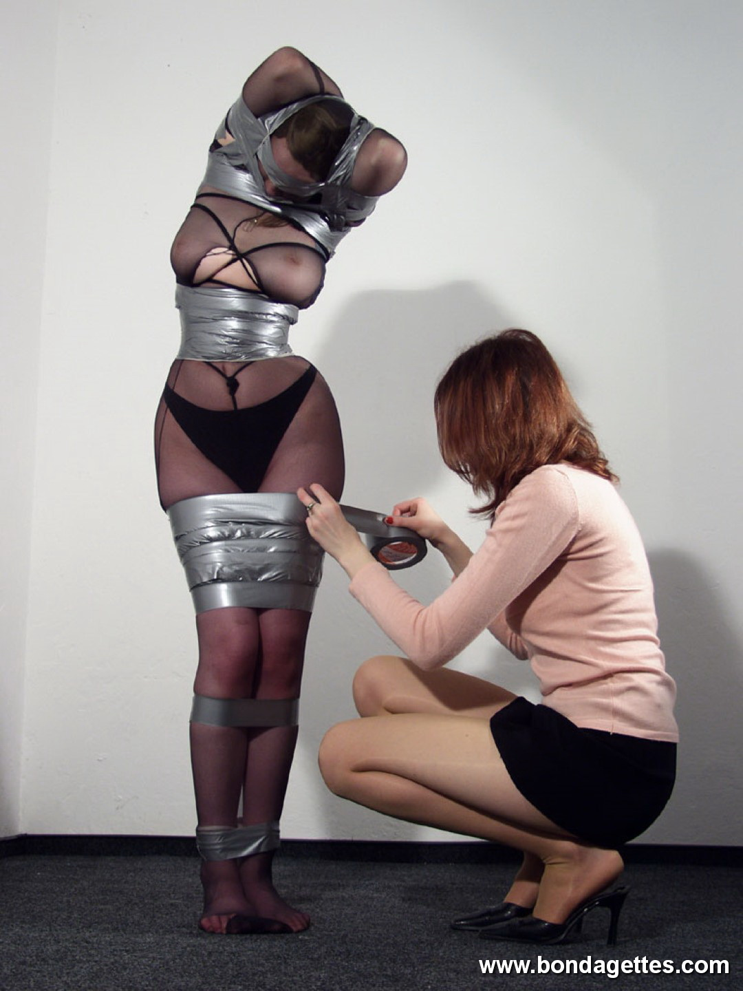 Lady natalie face sits on her mummified slave