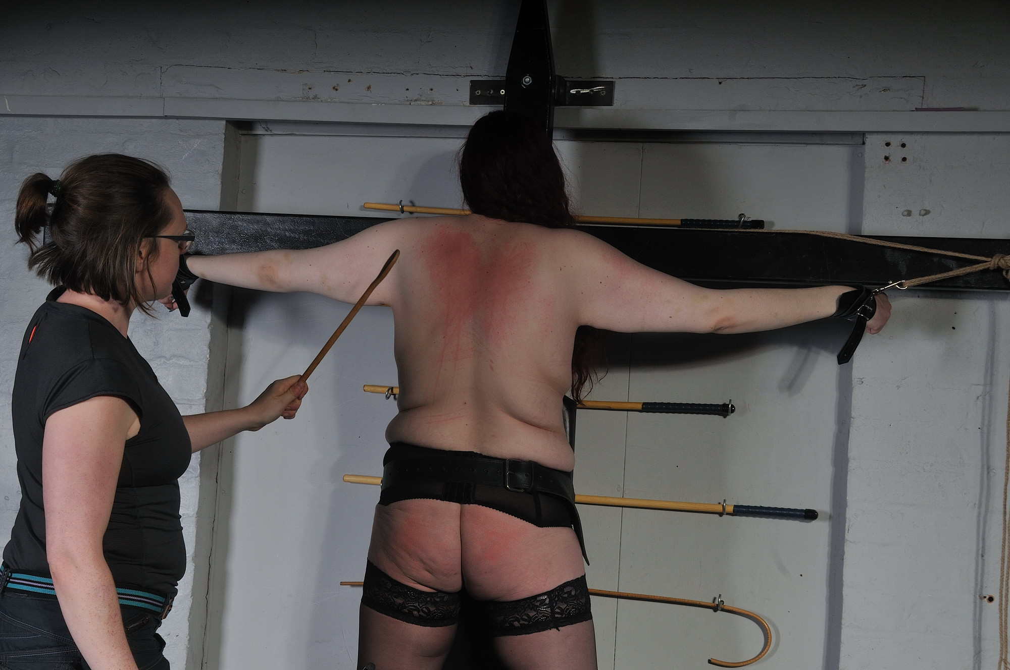 Faes bare ass spanking and corporal punishment of striped amateur slave in sever porn photo
